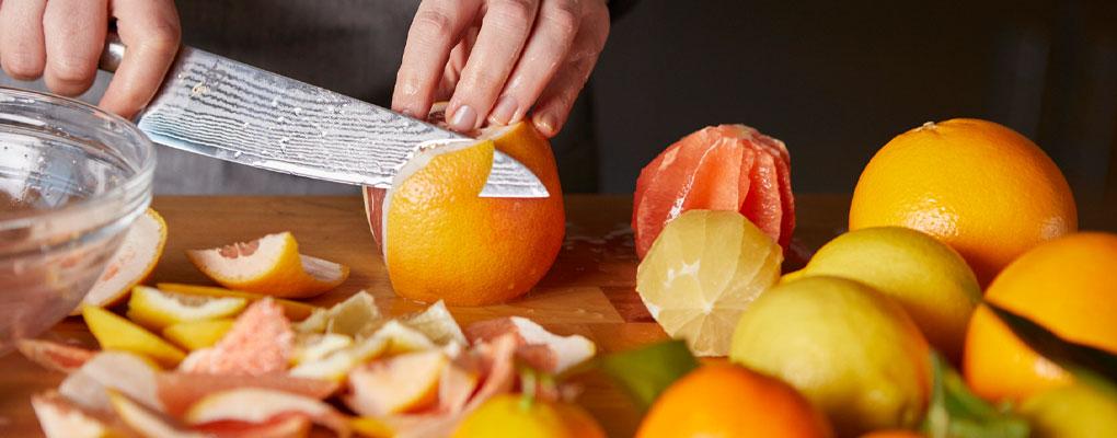 Chef peeling citrus fruits