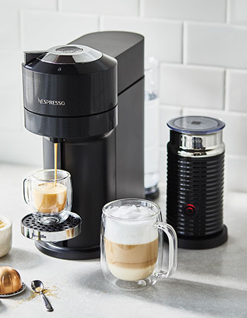Nespresso coffee maker brewing espresso