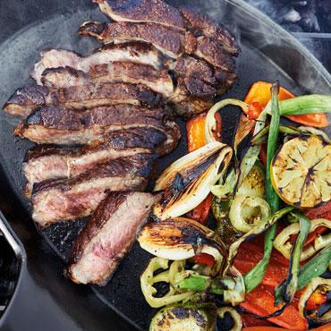 Skirt steak sliced with grilled vegetables