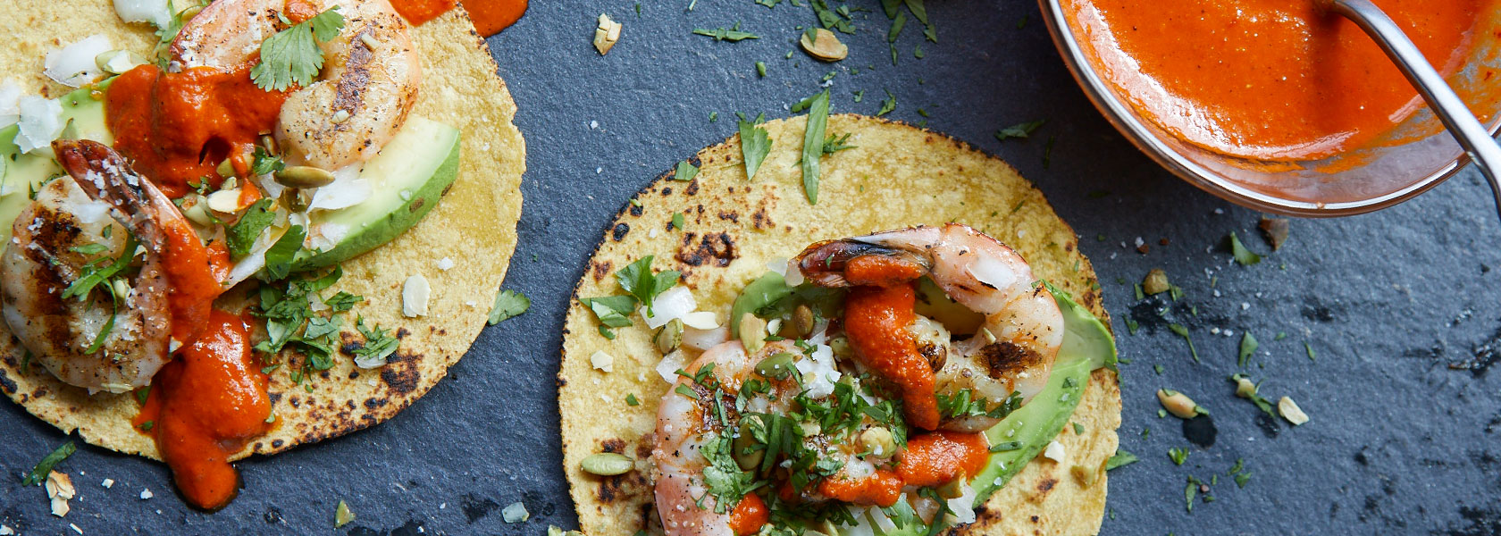 shrimp tacos with red salsa