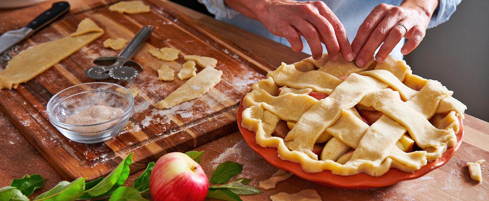Chef making fresh apple pie