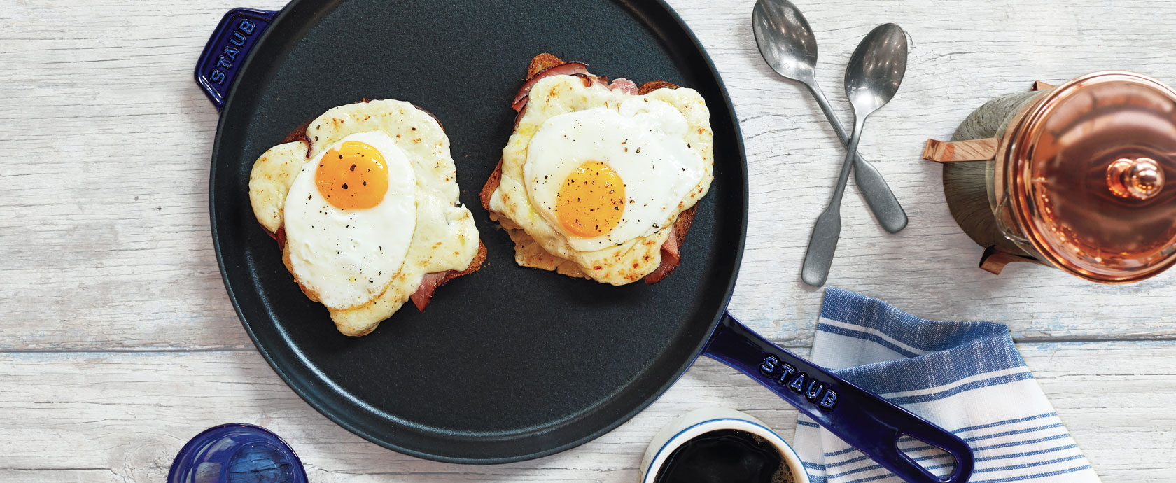 fried eggs in Staub cast iron skillet