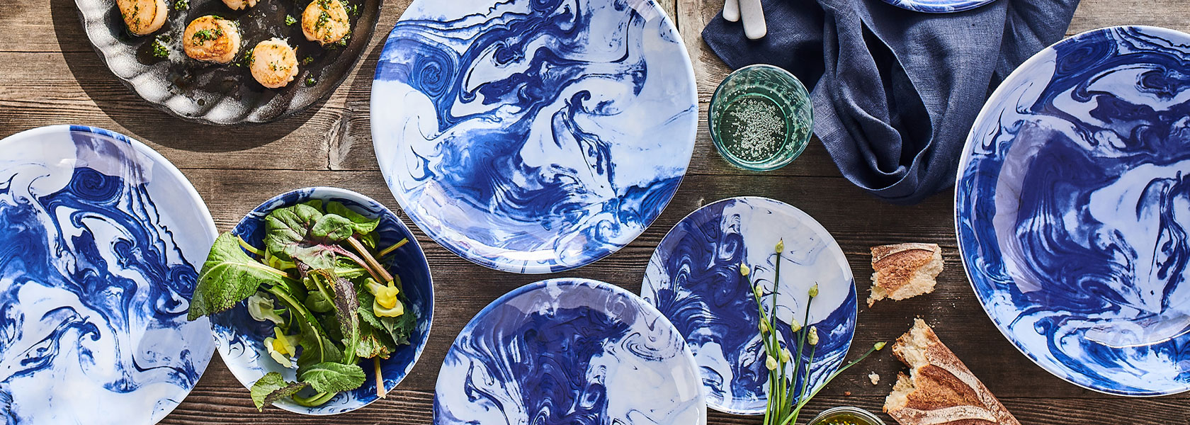 Oceana outdoor dinnerware on wooden table
