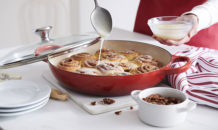 red pan with cinnamon rolls