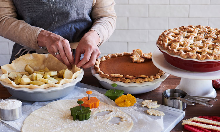 chef crimping crust for apple pie