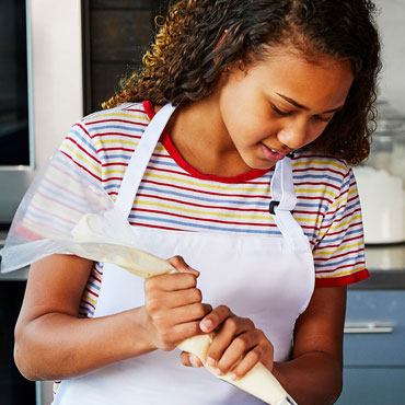 girl with pastry piping bag