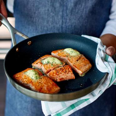 salmon in white wine in skillet