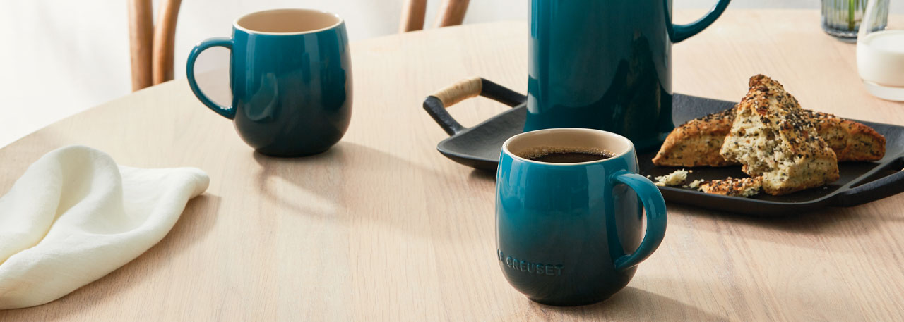 Le Creuset heritage mugs in deep teal color