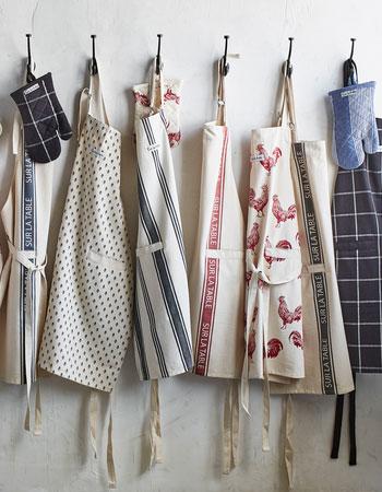 Fall aprons hanging on hooks